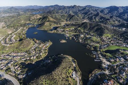 Aerial view of Lake Sherwood homes and the Santa Monica Mountains near Westlake Village and Thousand Oaks, California. Stock Photo