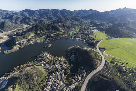 Aerial view of Lake Sherwood, Santa Monica Mountains and Potrero Road in scenic Hidden Valley near Westlake Village, Malibu and Thousand Oaks California.