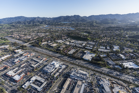 Aerial view of the Ventura 101 freeway and the Santa Monica Mountains in suburban Thousand Oaks near Los Angeles, California.