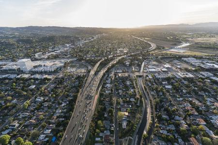 Late afternoon aerial view of Ventura 101 Freeway near Sepulveda Blvd in the San Fernando Valley area of Los Angeles, California.