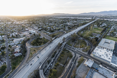 Late afternoon aerial of the Hollywood 170 freeway at Victory Bl in the San Fernando Valley area of Los Angeles, California. Stock Photo