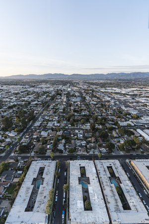 Vertical aerial view of San Fernando Valley homes, apartments and streets in the North Hollywood area of Los Angeles, California.