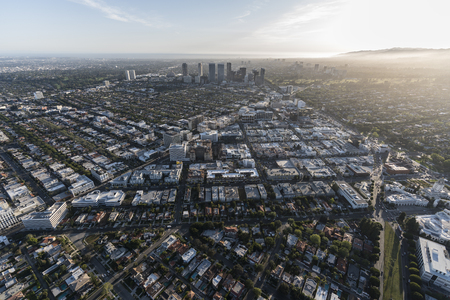 Afternoon aerial view of Beverly Hills and Century City buildings and streets in Los Angeles, California.