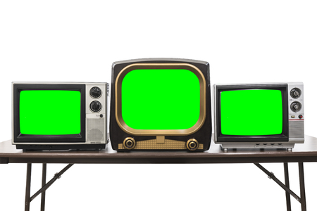 Three vintage televisions isolated on white with chroma key green screens and clipping path. 免版税图像