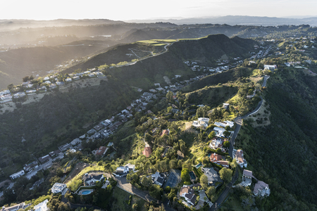 Aerial view of South Beverly Park hilltop homes in the Santa Monica Mountains above Beverly Hills and Los Angeles, California. Stock Photo