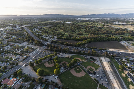 Afternoon aerial view of the Ventura 101 freeway and Sepulveda basin parks in the Encino area of the San Fernando Valley in Los Angeles, California. Stock Photo