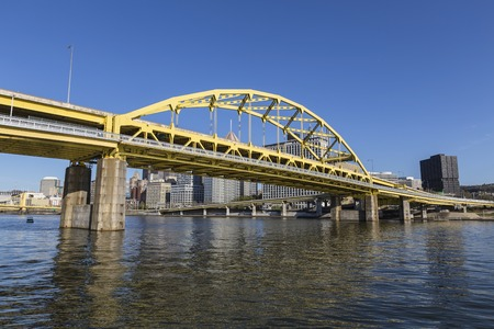 Downtown urban waterfront and Route 279 bridge crossing the Allegheny and Ohio Rivers in Pittsburgh, Pennsylvania.