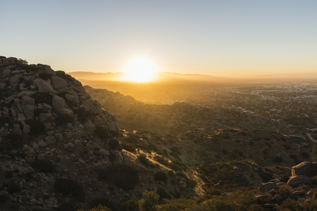 Sunrise view of the San Fernando Valley in Los Angeles, California.  Shot from the Santa Susana Mountains looking east towards the San Gabriel Mountains. Stock Photo