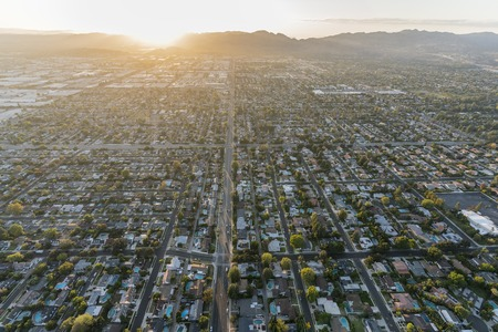 Sunset aerial view down Lassen Street in the Chatsworth area of the west San Fernando Valley region of Los Angeles, California.