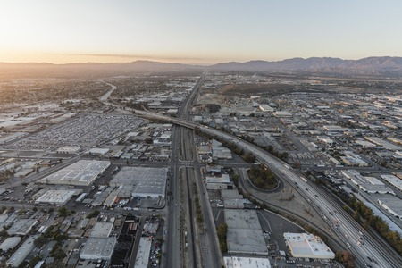 Dusk aerial view of industrial buildings along the 5 freeway and San Fernando Road in the Sun Valley area of Los Angeles, California. 스톡 콘텐츠