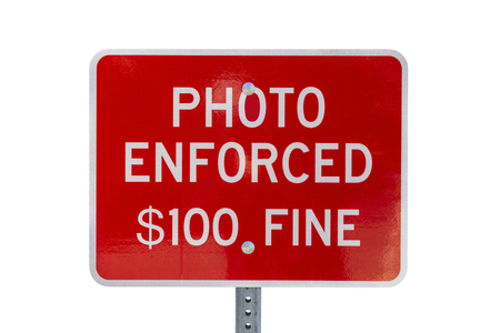 Photo enforced $100 fine stop sign warning notice isolated on white.