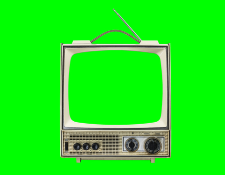 Grungy vintage portable television isolated with chroma green screen and background.