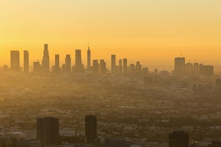 Los Angeles California orange sunrise cityscape view.  Shot taken hilltop in the Santa Monica Mountains.   Banco de Imagens