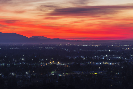 Colorful predawn view of San Fernando Valley neighborhoods and the San Gabriel Mountains in the city of Los Angeles, California.