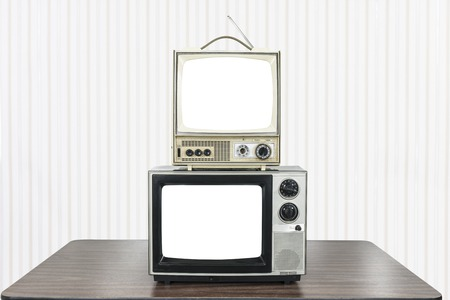 Two vintage television on old table with cut out screens. 版權商用圖片 - 118051608