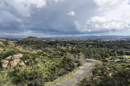 Scenic view of spring storm clouds, Stoney Point Park and the San Fernando Valley near Topanga Canyon Blvd and Santa Susana Pass Road in the City of Los Angeles, California. Stock Photo