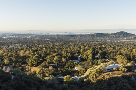 Morning view of Altadena, Pasadena and downtown Los Angeles from San Gabriel Mountains hilltop in Southern California.