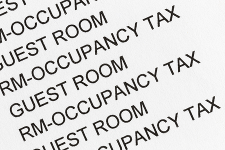 Macro detail of hotel guest room and occupancy tax paper bill payment receipt. 版權商用圖片
