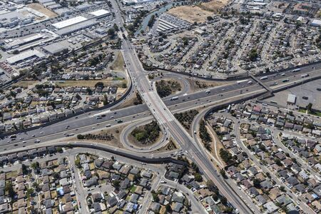 Aerial view of streets, buildings and traffic along the 880 freeway at 98the Ave in Oakland California.
