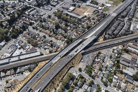 Aerial view of streets, buildings and traffic along the 238 freeway railroad overpass near Oakland California.