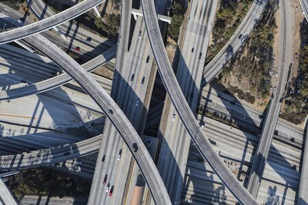 Afternoon aerial above the Harbor 110 and Century 105 freeways interchange ramps in Los Angeles, California. Stock Photo