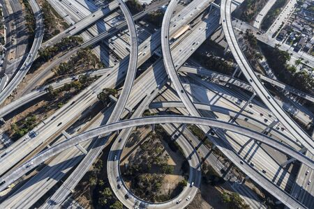 Aerial view of the 110 and 105 freeway interchange ramps and bridges south of downtown Los Angeles in Southern California. Stock Photo