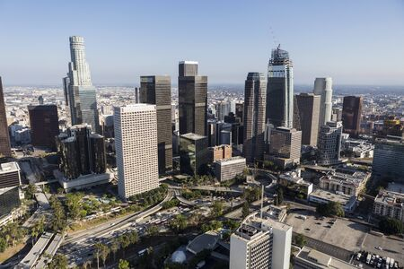 Afternoon aerial of freeway, streets, towers and buildings in sprawling downtown Los Angeles, California. 스톡 콘텐츠