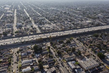 Aerial view of buildings, homes and streets near the Harbor 110 freeway south of downtown Los Angeles in Southern California.