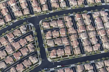 Aerial view of dense tract home rooftops in Los Angeles, California.