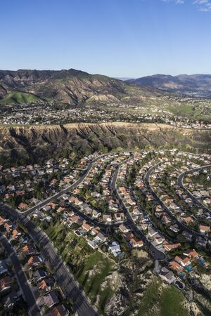 Vertical aerial view of Porter Ranch homes and Oat Mountain in the San Fernando Valley area of Los Angeles, California.