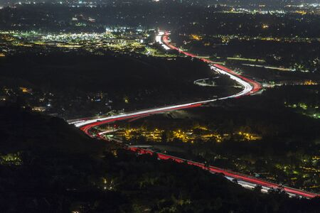 Night view of predawn Los Angeles California freeway traffic on route 118 at Porter Ranch in the San Fernando Valley.