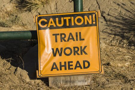 Caution trail work ahead temporary sign posted at nature park entrance.