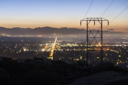 Predawn view of power lines entering the San Fernando Valley in Los Angeles California.  The San Gabriel Mountains are in background. Foto de archivo