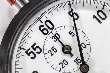 Macro close up detail of vintage stop watch.