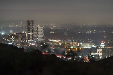 Foggy night view of the Burbank media district in the San Fernando Valley area of Los Angeles, California.  Shot from hilltop in popular Griffith Park.