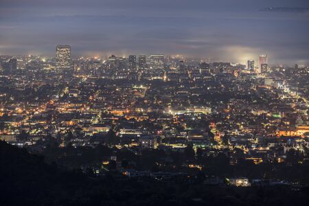 Foggy predawn twilight view of the Hollywood area of Los Angeles, California.  Photograph taken from mountaintop in popular Griffith Park.