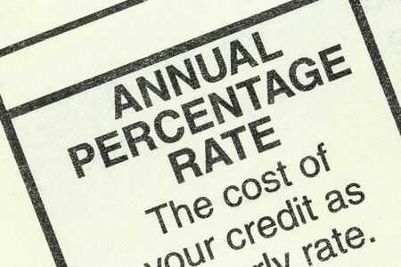 Close up macro view of annual percentage rate detail in the standard federal truth in lending section on an automobile purchase form.
