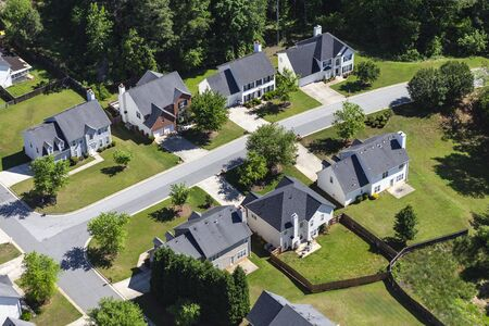 Aerial view of attractive contemporary homes and streets in the southeastern United States.