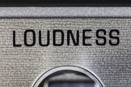 Close up macro photograph of loudness switch on vintage boombox. Stock Photo