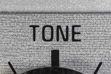 Close up macro photograph of tone dial on vintage boombox stereo. Banco de Imagens