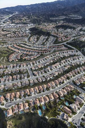 Vertical aerial view of modern suburban housing in the Porter Ranch community of Los Angeles, California.