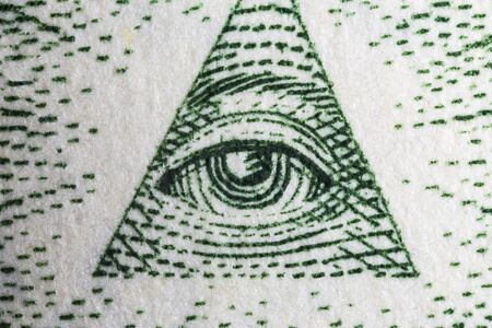Macro close up photograph of the Eye of Providence on the US one dollar bill. Stock Photo