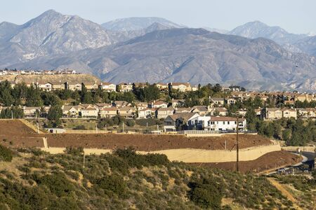 Hilltop houses overlooking the San Fernando Valley in the Porter Ranch neighborhood of Los Angeles, California.  The San Gabriel Mountains and Angeles National Forest are in the background.