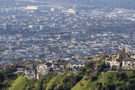 Hilltop homes above Los Angeles County smog in the Verdugo Hills area of Glendale California. 스톡 콘텐츠
