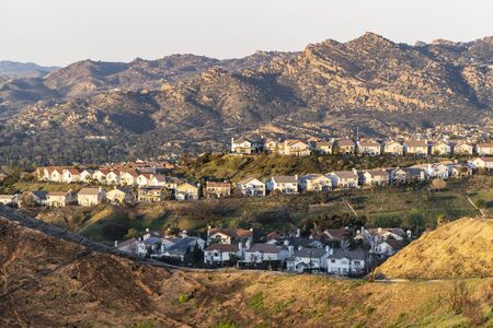 Hilltop homes overlooking the San Fernando Valley in northern Los Angeles, California.  The Santa Susana Mountains are in the background.
