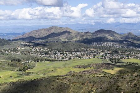 Mountaintop view of National Park meadows and suburban housing tracts in scenic Newbury Park near Thousand Oaks and Los angeles, California.
