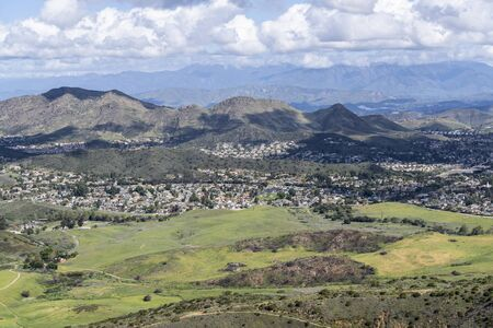 Mountaintop view of nature park meadows and suburban homes in scenic Newbury Park near Los Angeles, California.