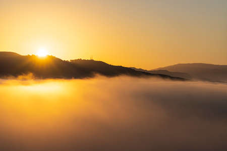 Sunrise cloud top view towards Oat Mountain from Rocky Peak Park in the Santa Susana Mountains between Los Angeles and Ventura County in Southern California.