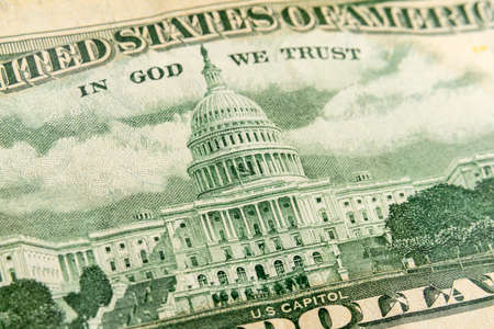 Macro photograph of the US Capitol building on back of a fifty dollar bill.