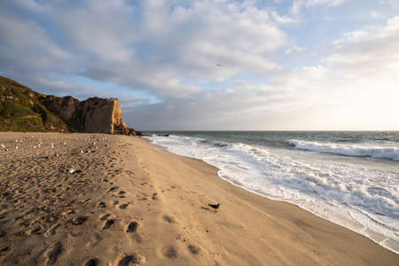 Afternoon view of scenic Westward Beach and Point Dume State Park in Malibu, California.